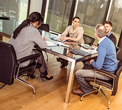Group of co-workers collaborating in meeting room