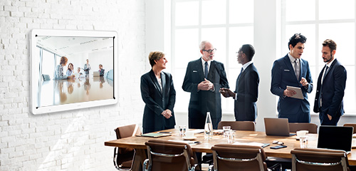 Workers in conference room using interactive whiteboard