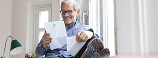 Man reviewing energy related mail