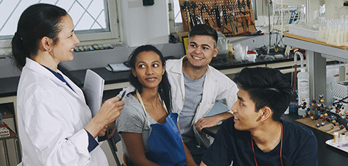 instructor and students in a chemistry class