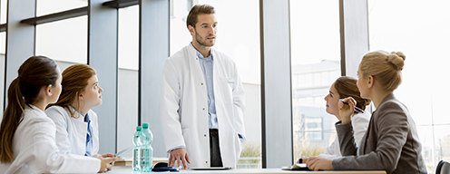 doctors talking to a consultant at a table