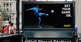 Billboard above subway of player kicking soccer ball