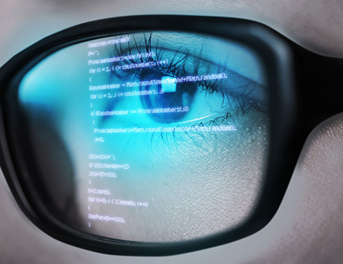 closeup of data reflecting in eye glasses