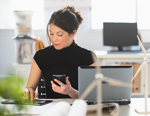 woman working on mobile device