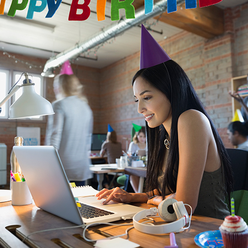 Girl at desk with computer celebrating her birthday