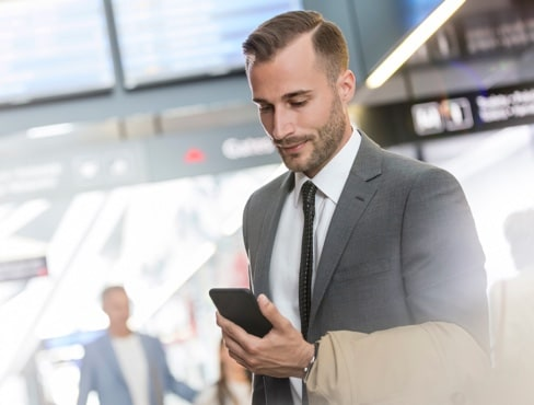 Business man traveling in suite with phone