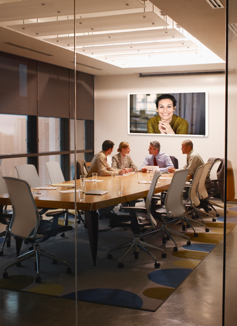 Conference room with Interactive whiteboard at end of meeting table