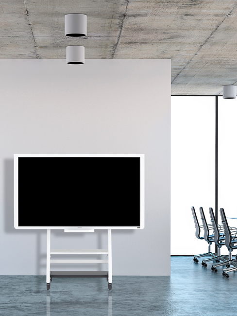 Interactive whiteboard against wall in modern office space