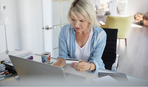 Woman paying with credit card online