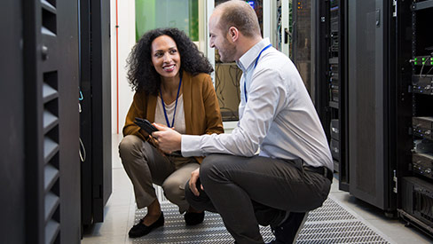 man and woman working in data center