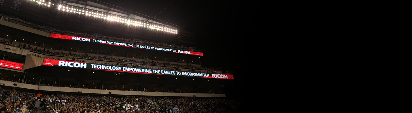 philadelphia eagles stadium at night with Ricoh banner