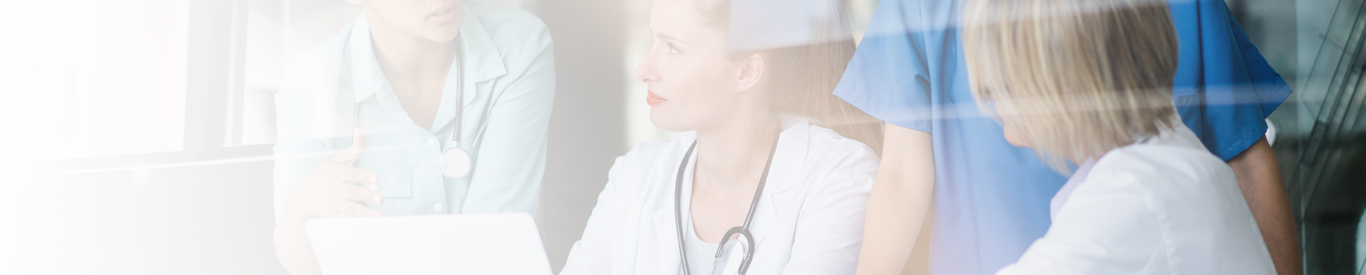 connected healthcare critical questions doctors around laptop