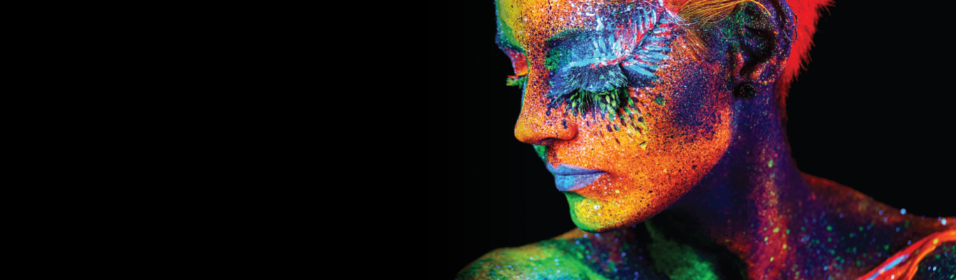 woman with painted face bold bright vivid colors on black background