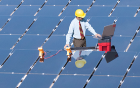 Technician working on solar panels