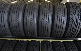 Group of new tires for sale at a tire store.
