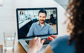Tile image of a woman talking to a man via webcam.
