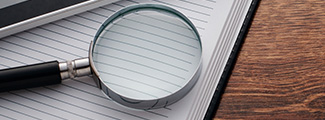 Magnifier on top of notebook.