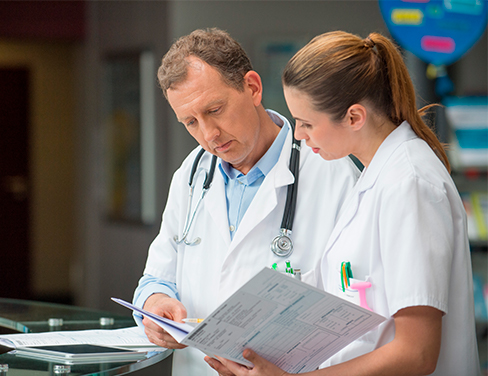 Doctor and nurse looking at patient documents