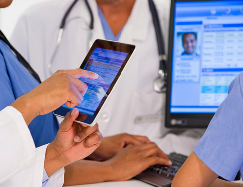 doctors looking at patient records