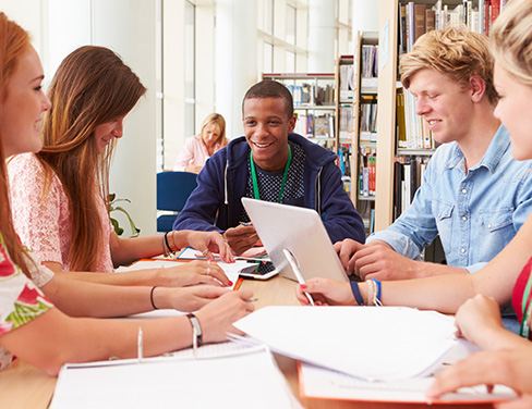 Students collaborating around a table