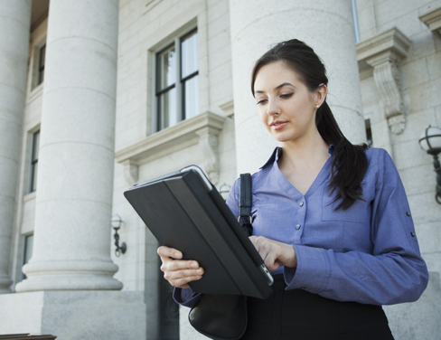 Businesswoman using digital tablet outdoors