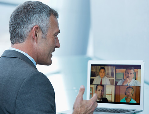 Man talking to four people on a video conference.