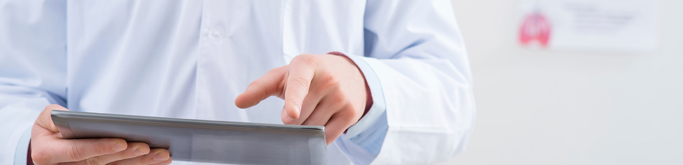 Doctor holding tablet