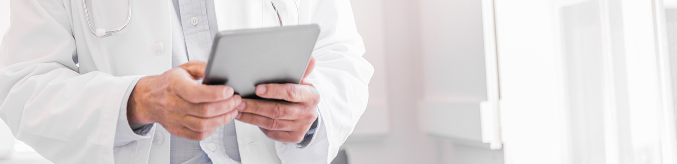 Doctor using tablet device