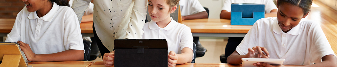 Middle school students using tablets in class