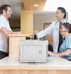 SP 5310DN printer on desk in lobby of doctor's office